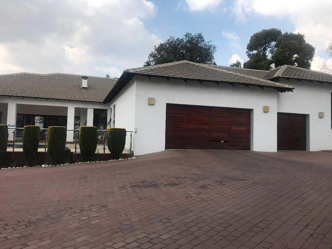 front view of house with three garages.