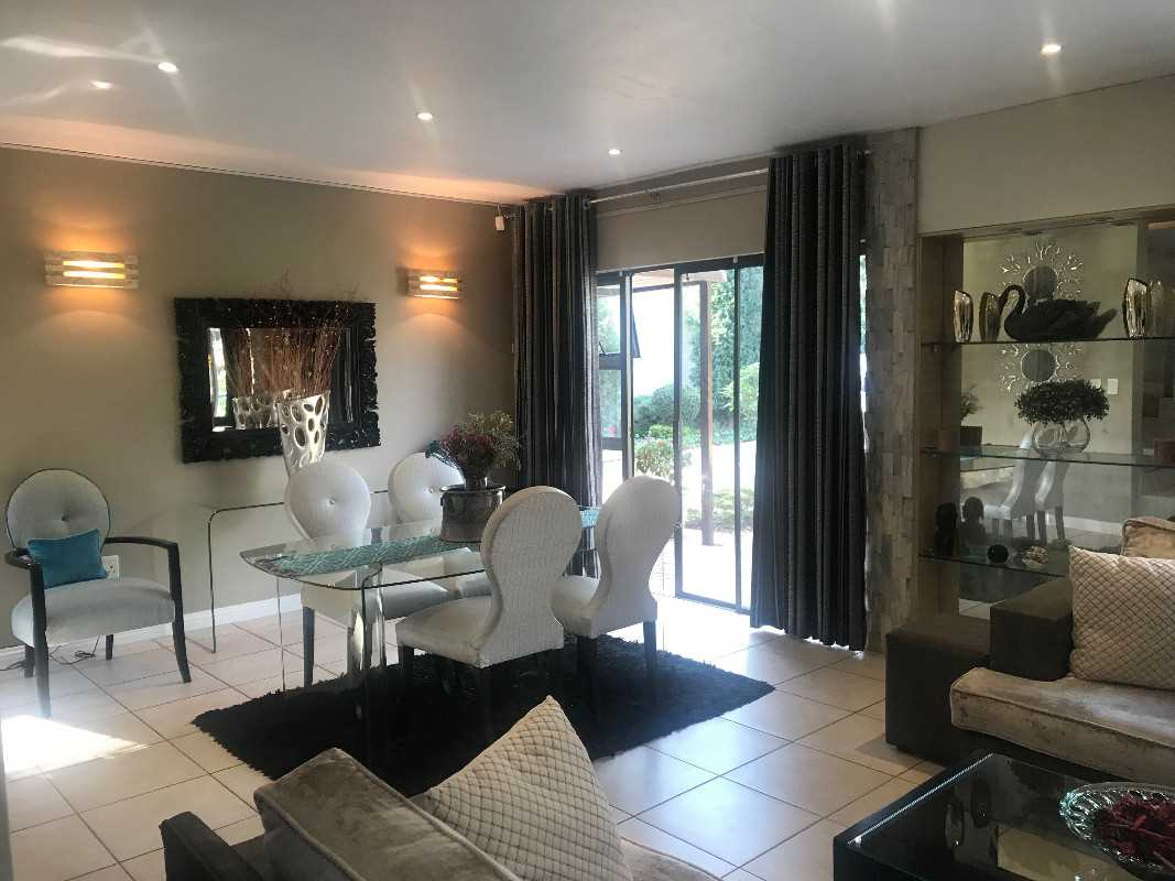 dining area and lounge leading to garden