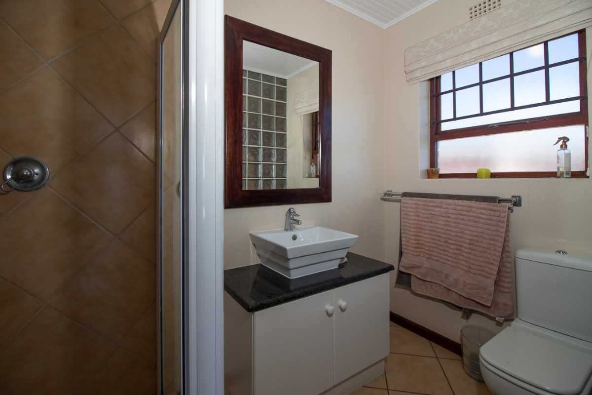Master bedroom en-suite bathroom with shower, basin and toilet