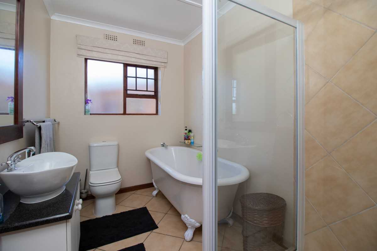 Main bathroom with bath, shower, toilet and basin