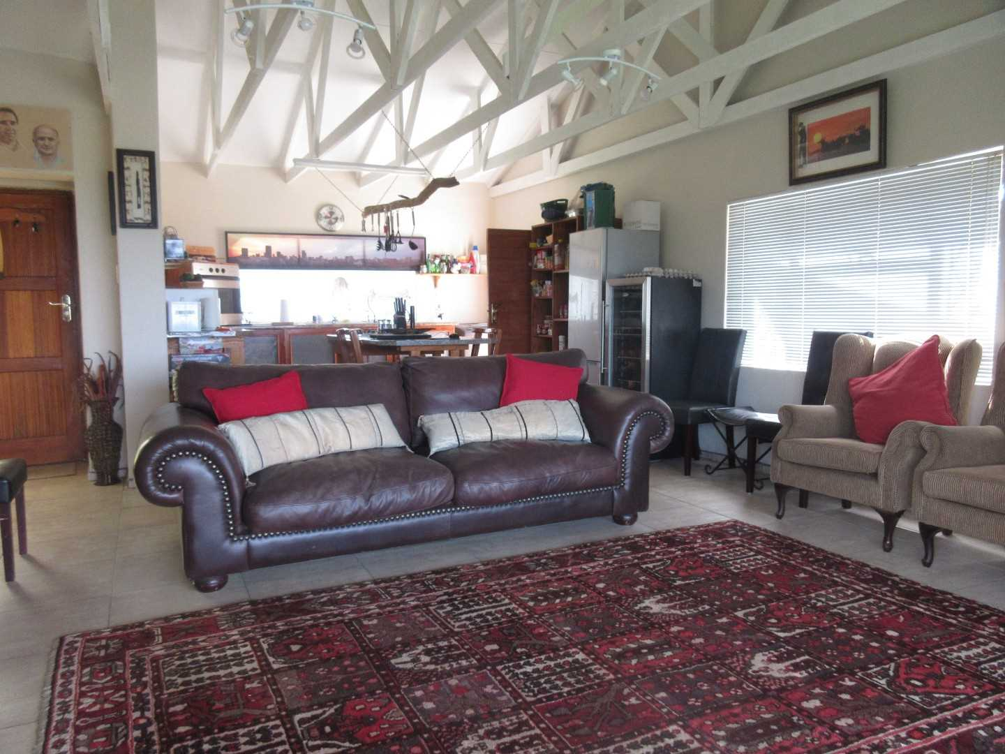 Open plan living area leading onto covered entertainment area