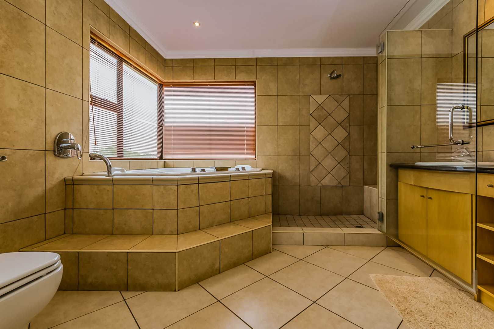 Main ensuite Bathroom with spa bath and shower