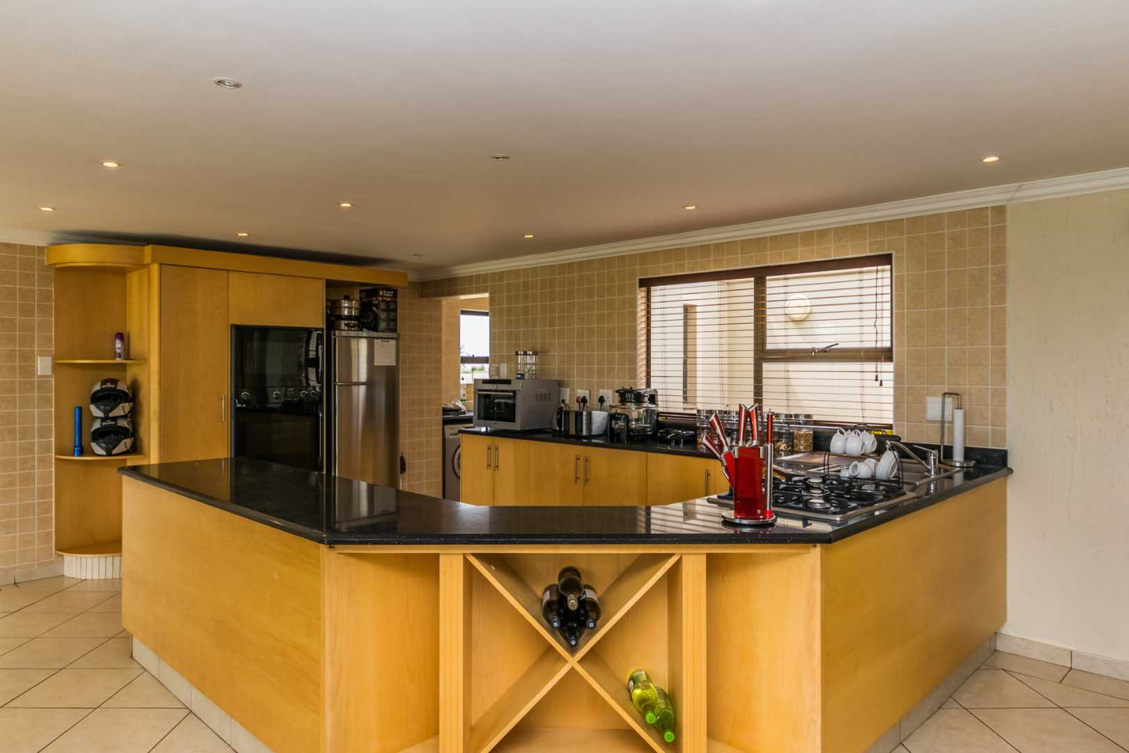 Kitchen with Granite Tops and Gas hob.