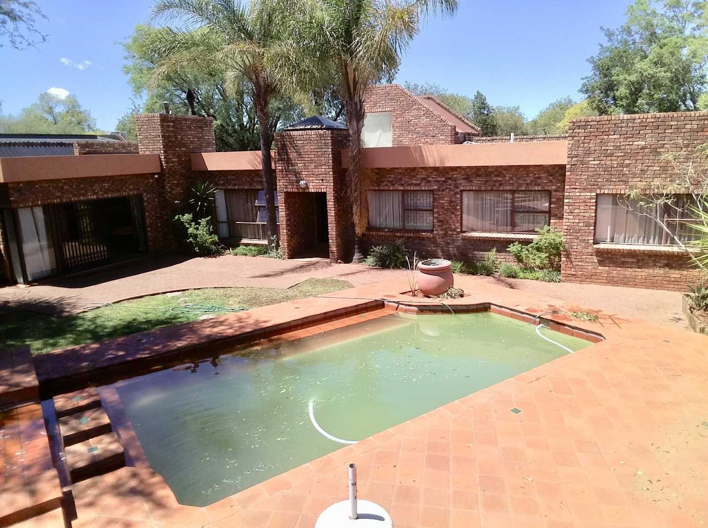Front View from the lapa with braai. Low maintenance home with 5 bedrooms 4 bathrooms, 4 living rooms, 4 garages. Pool & Lapa.