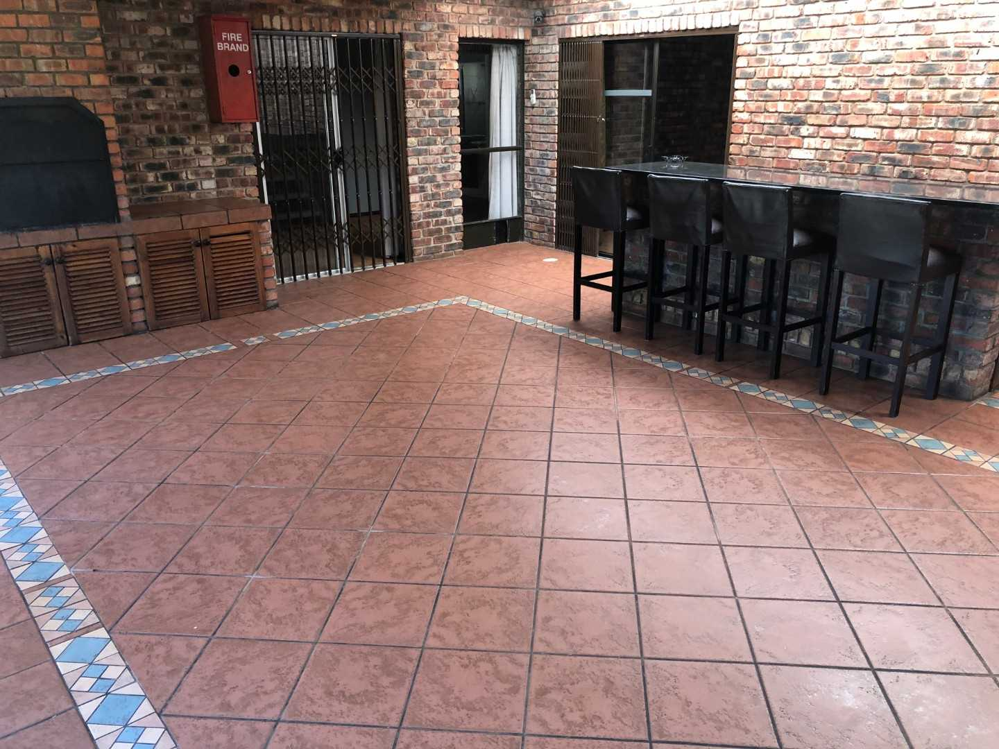 Barroom with sliding doors to back garden and build in braai with aircon - serviced from kitchen