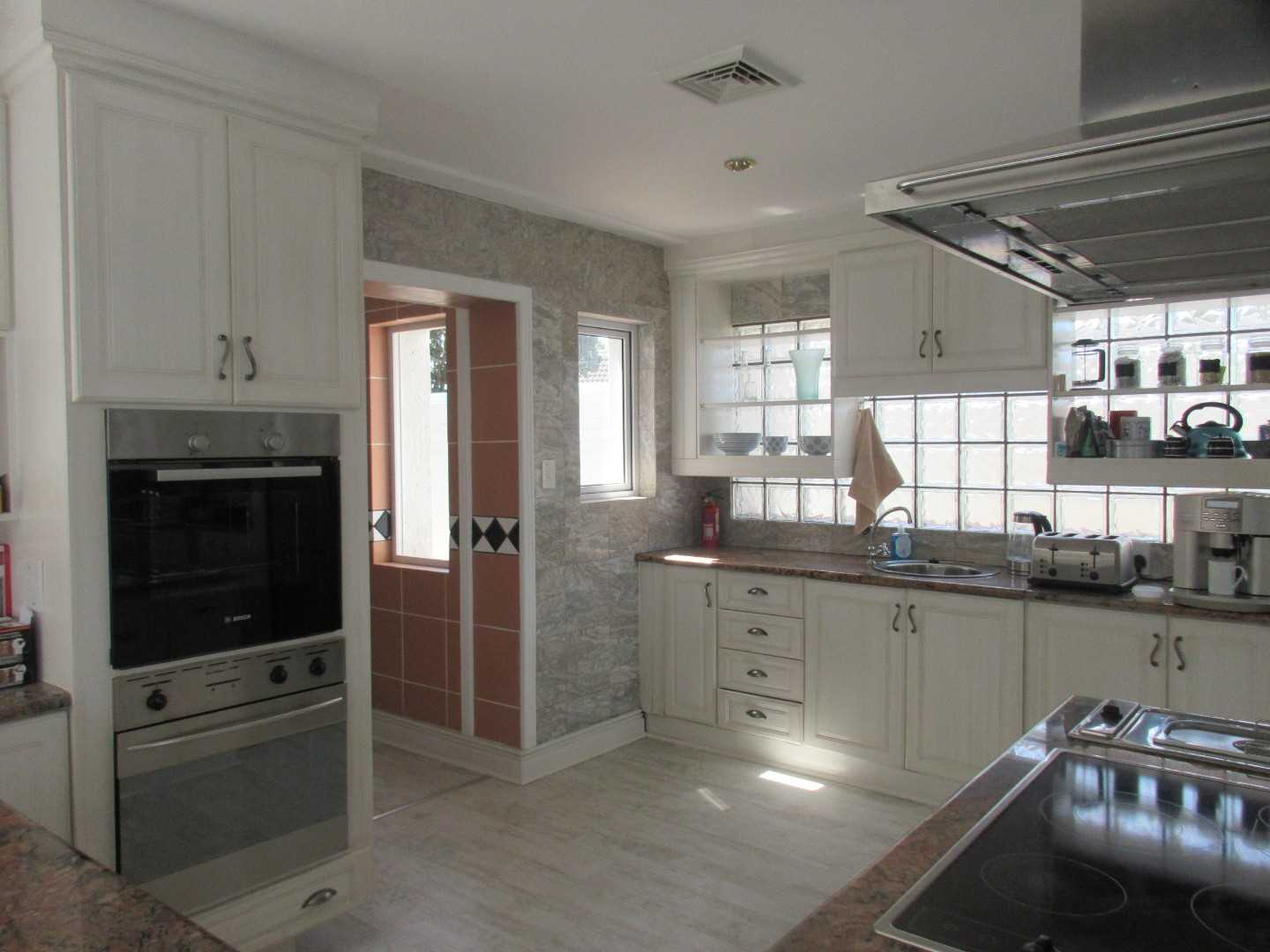 Modern kitchen leading off to a scullery and utility room