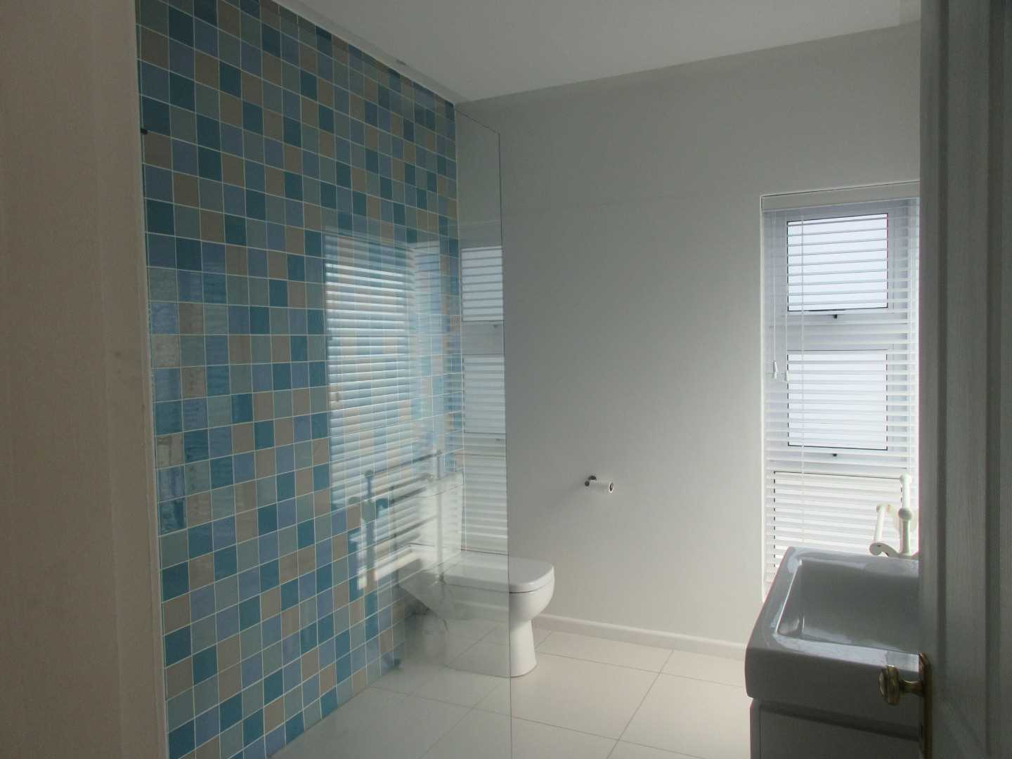 Children's room en-suite bathroom with bath and shower