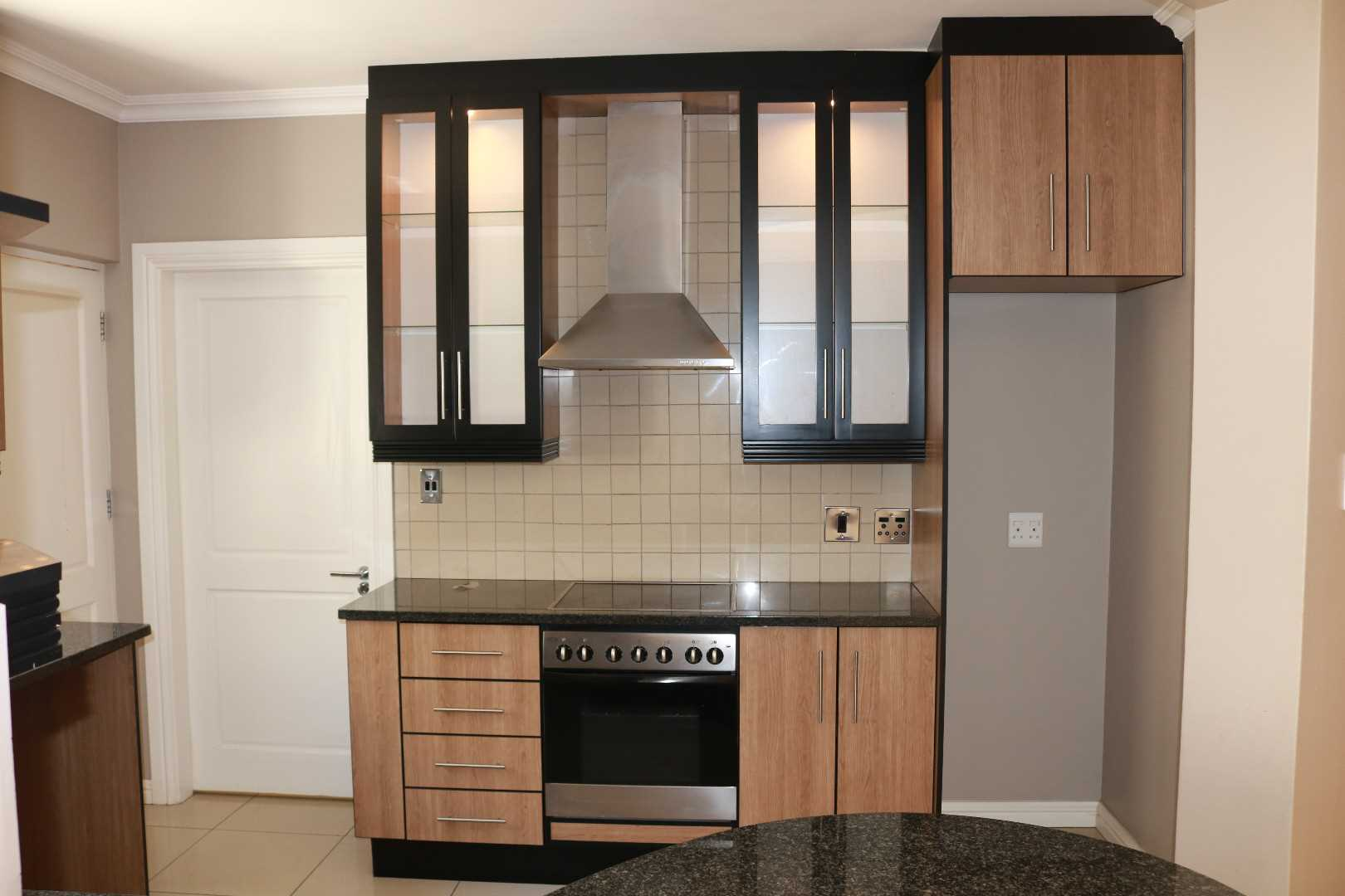 Kitchen showing oven and hobb