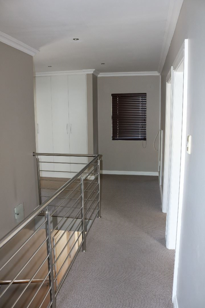 upstairs landing with storage cupboards and work desk nook