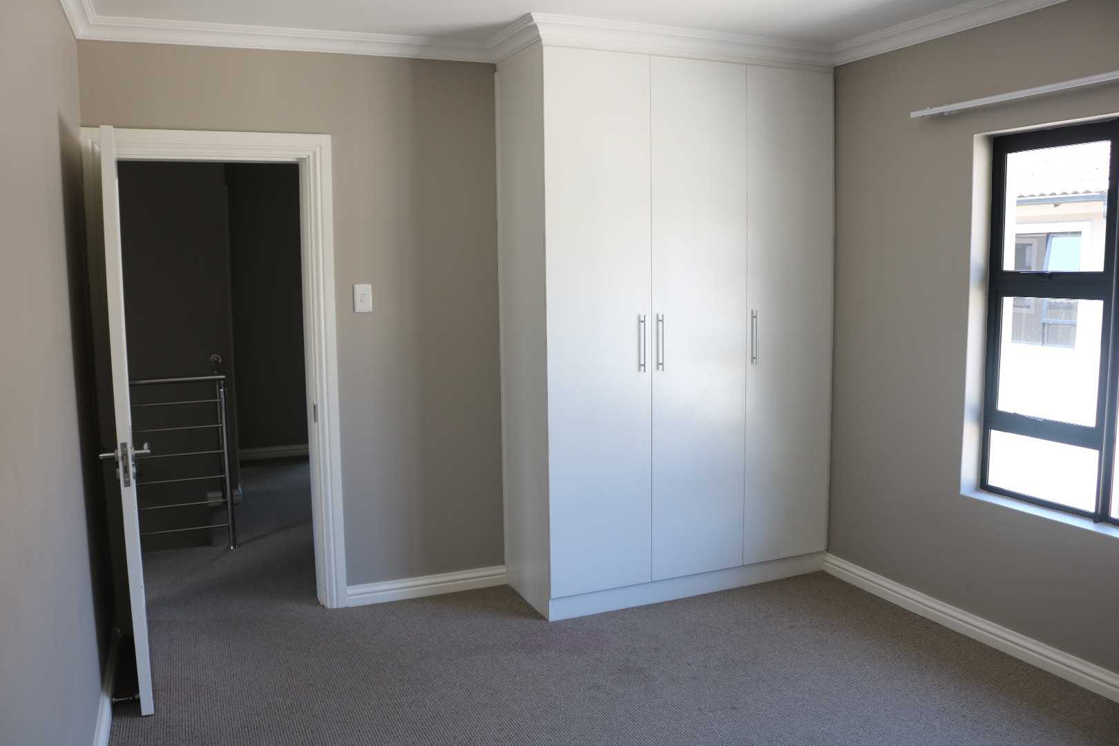 2nd bedroom with bic and entrance view