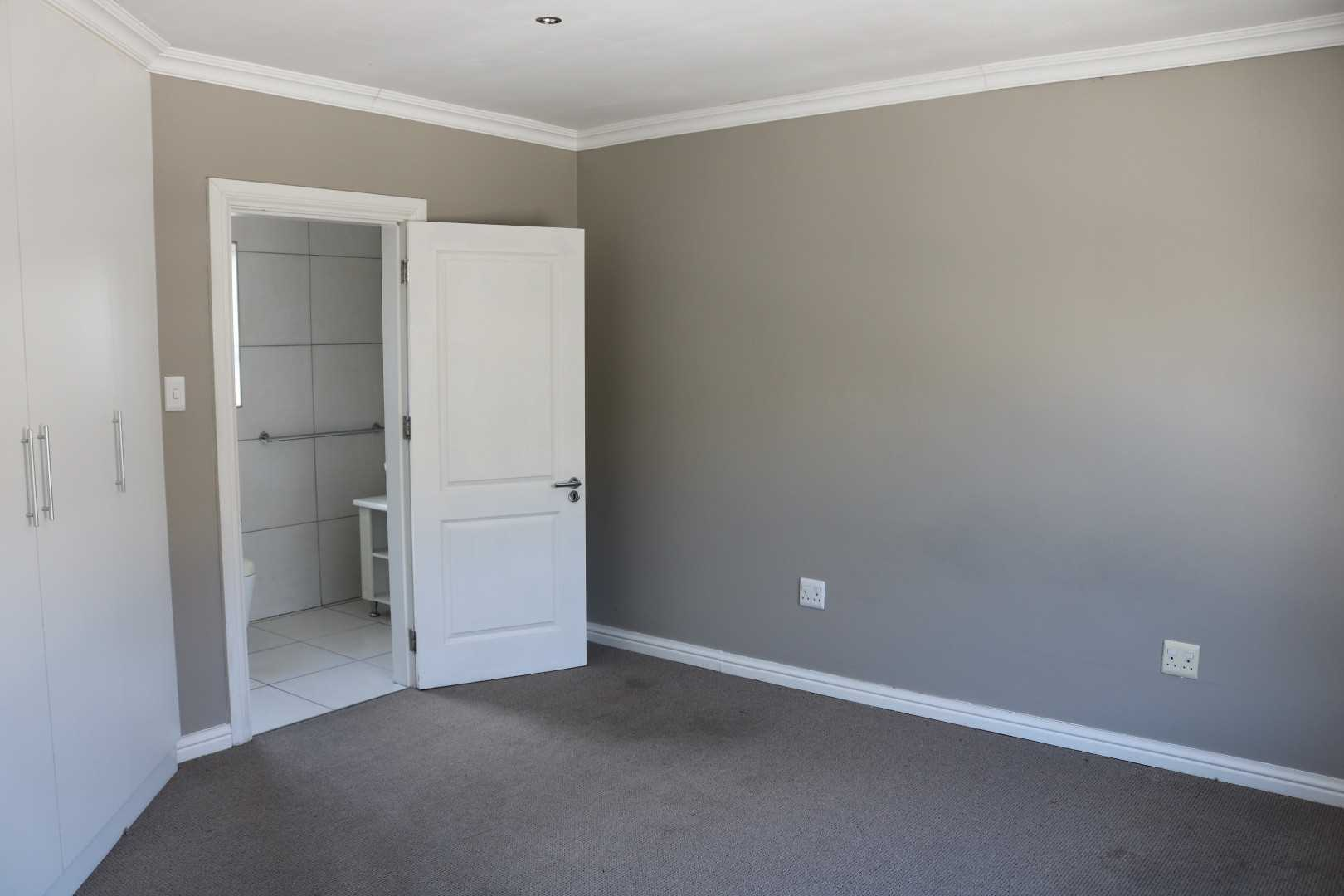 main bedroom with bic and en-suite entrance view