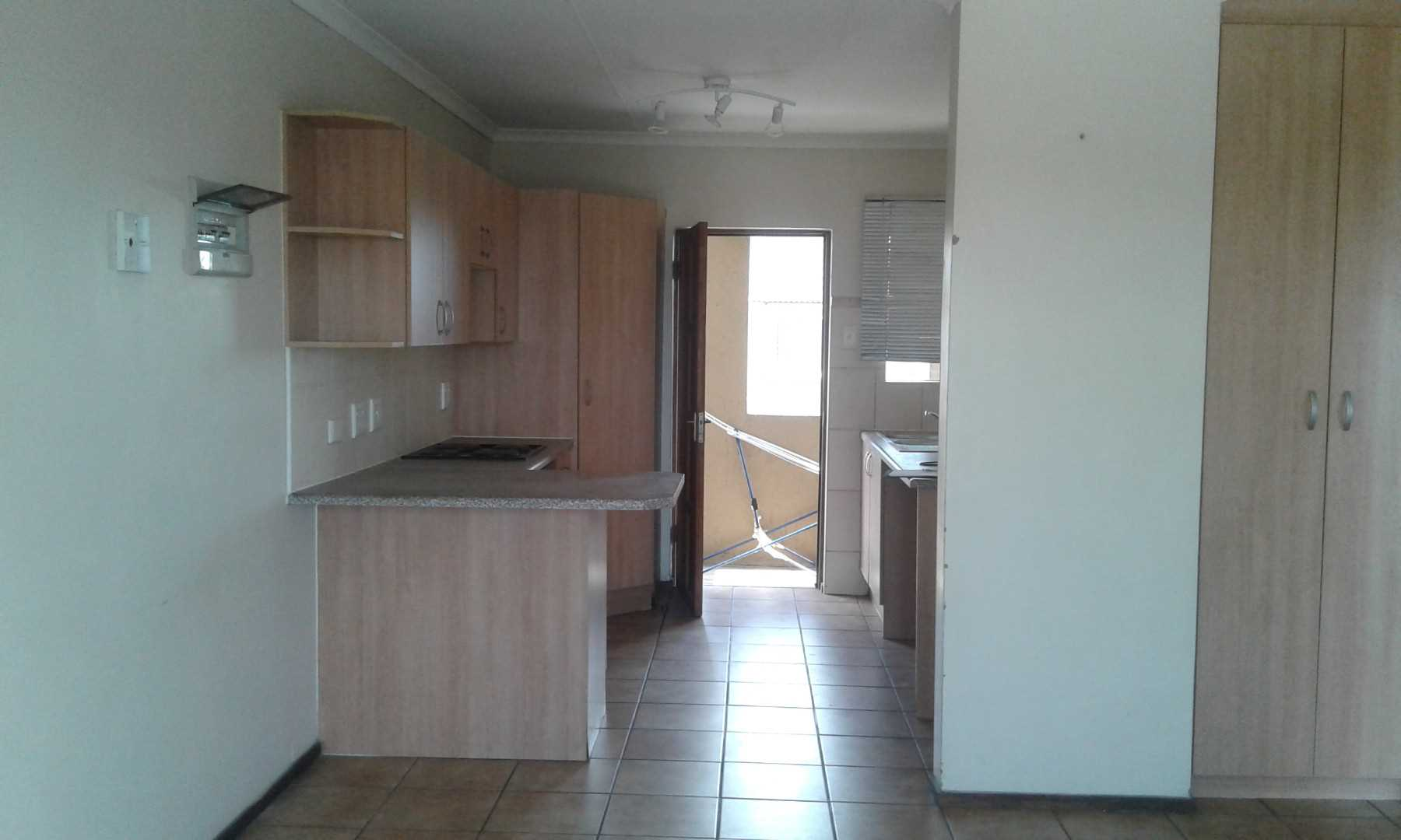Kitchen is open plan with living room.