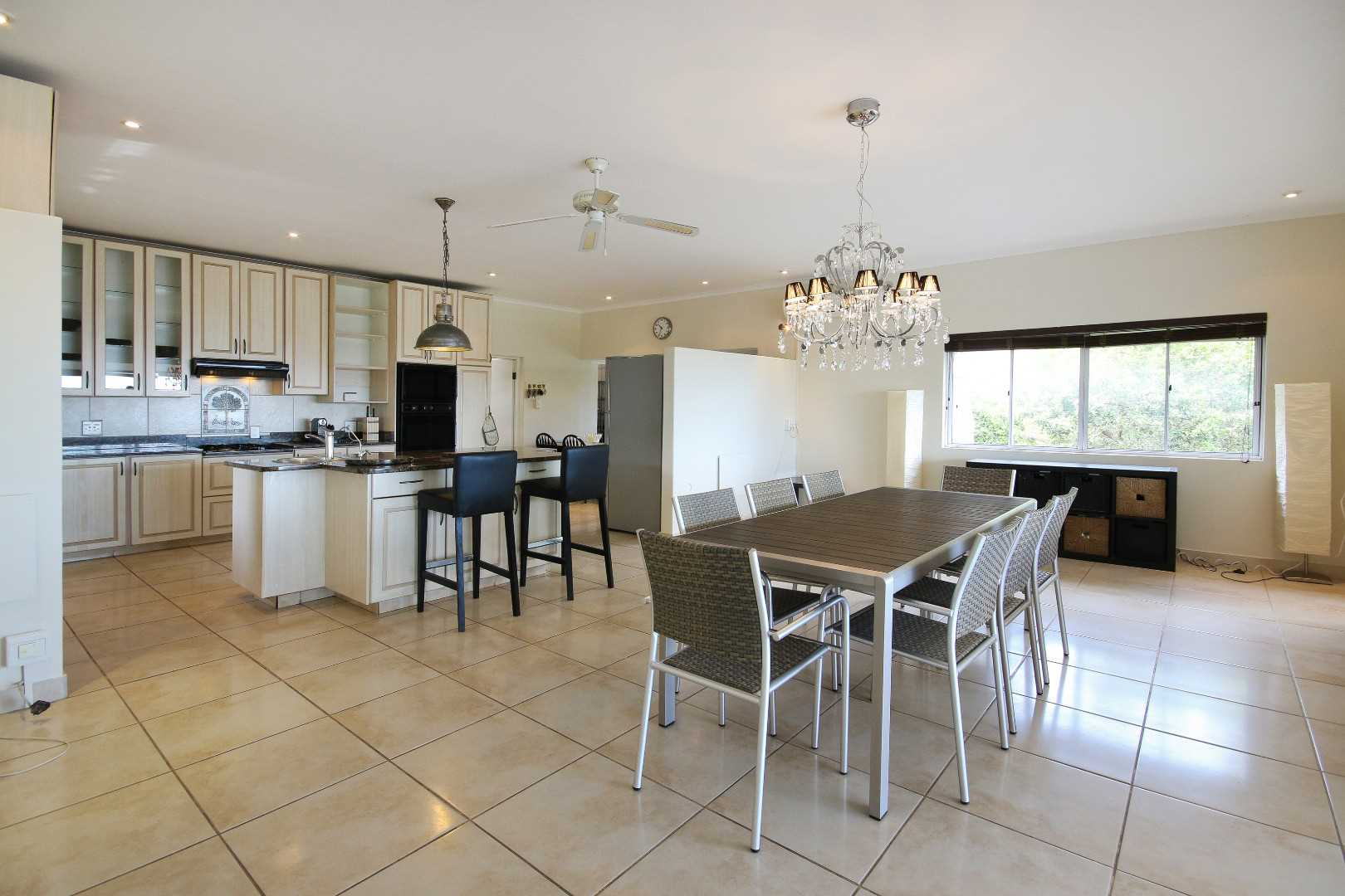 Open plan dining to kitchen and breakfast counter