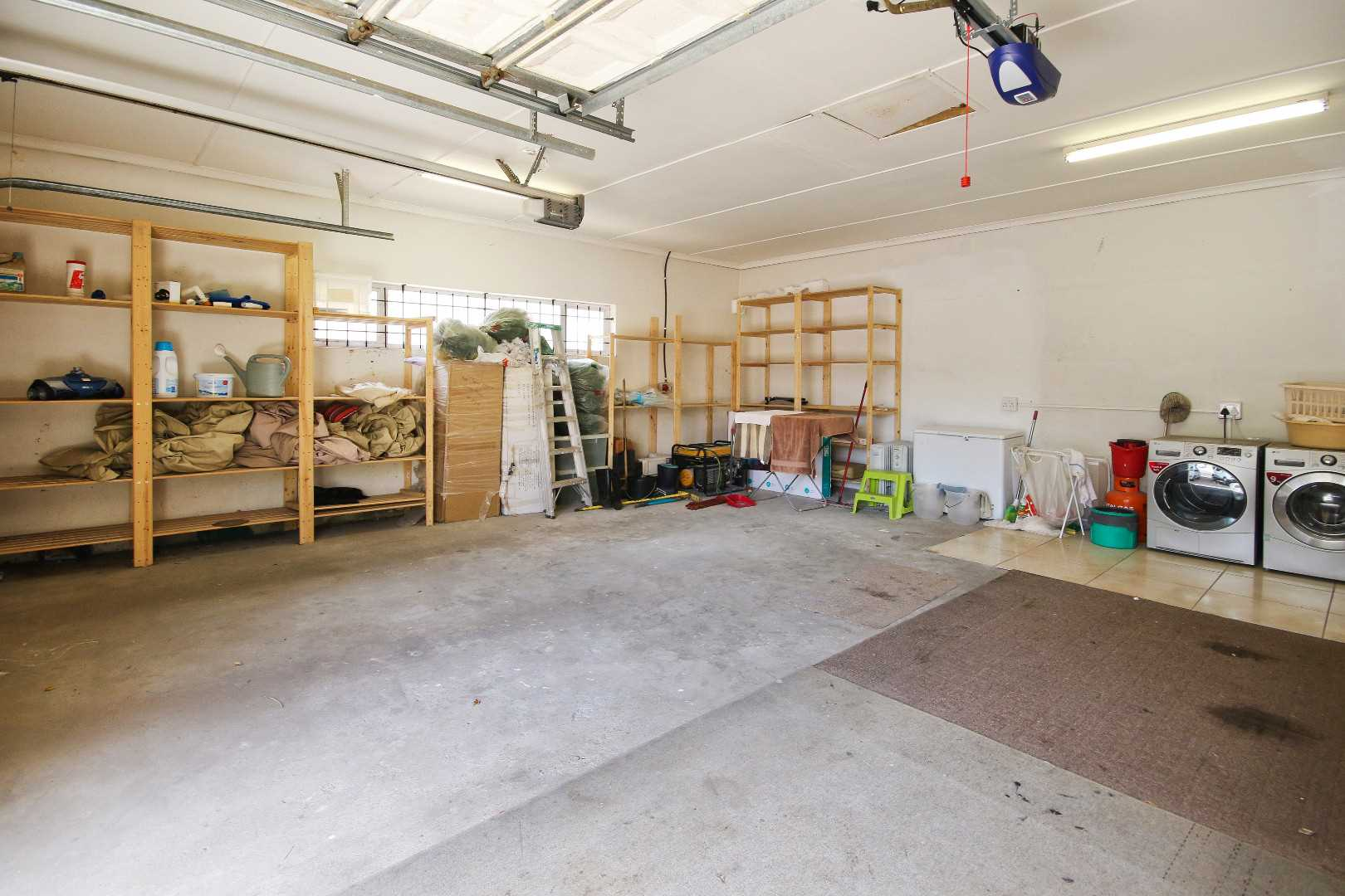 spacious double garage with automated sliding doors (2 units). Laundry in garage