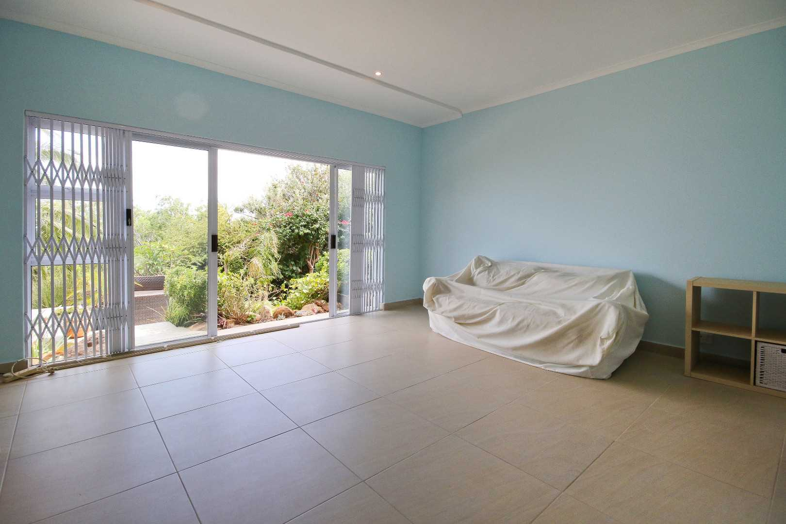 Sliding doors from bedroom lead to private garden and pool