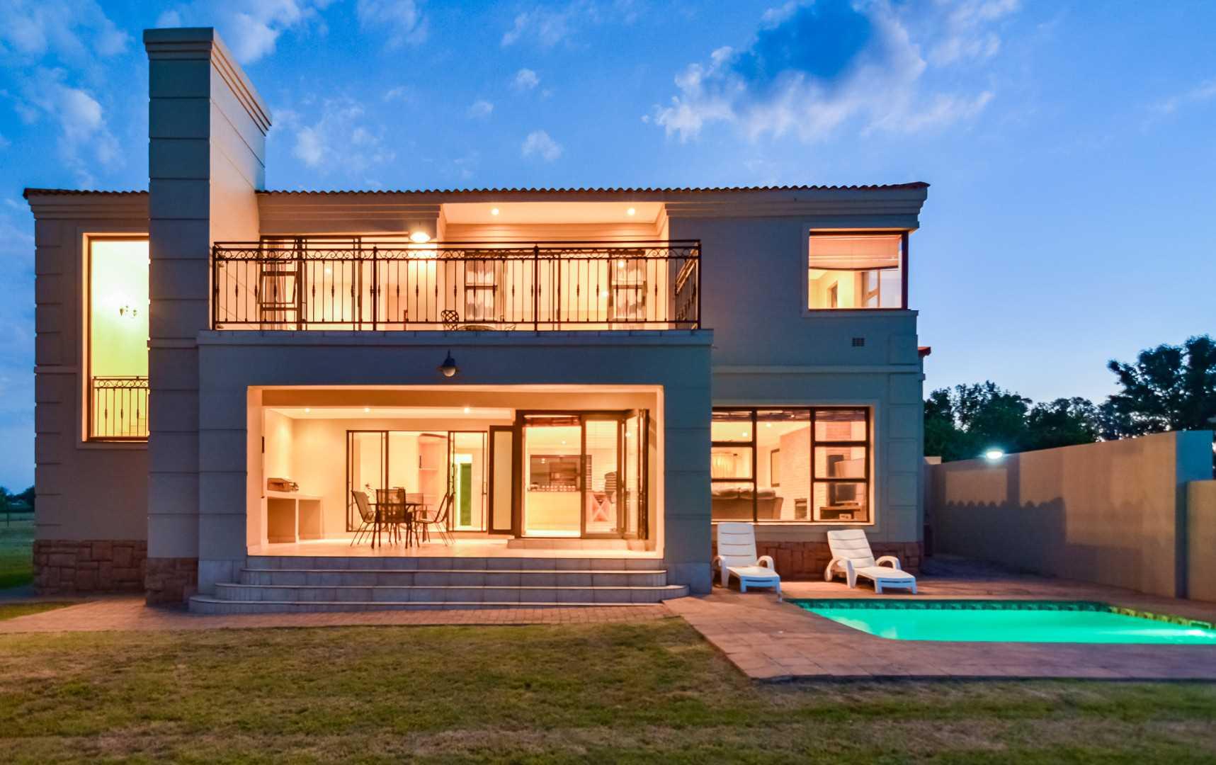 Twilight shot of 58 Club Milos, Riverfront Luxury Estate