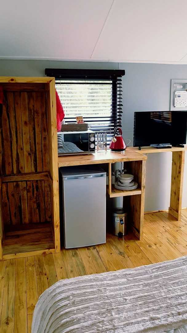Space for a small fridge or cupboard.