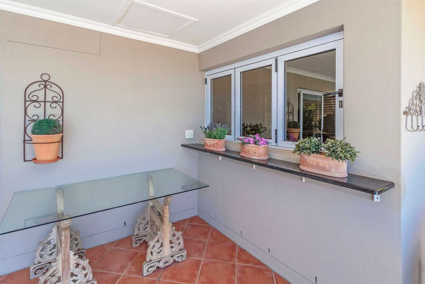Patio outside kitchen, with stacking windows
