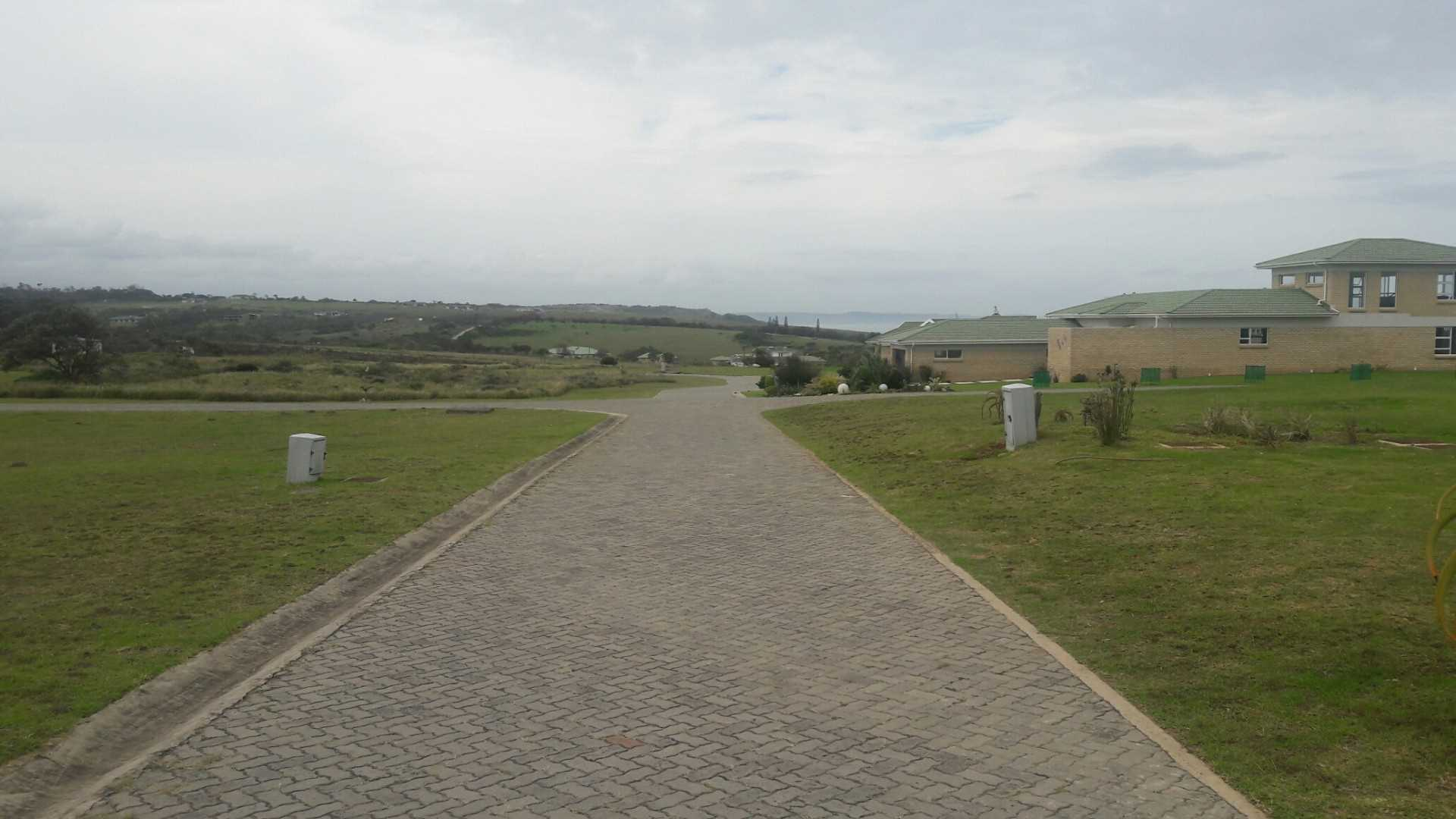 ENTRANCE ROAD ON LEFT - RIGHT TURN INTO ROAD LEADING TO PLOT