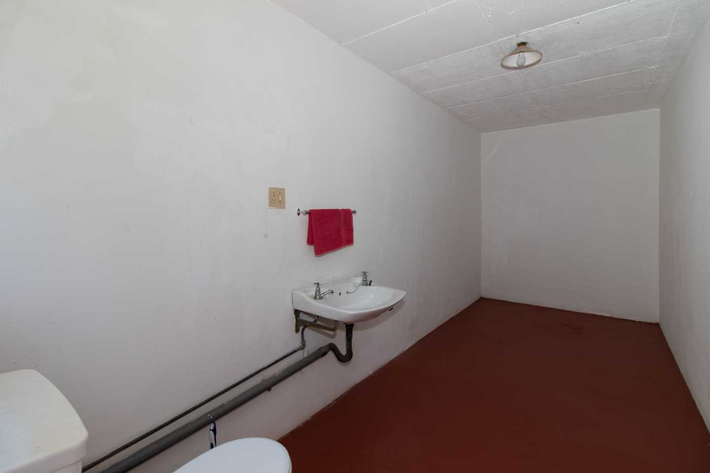 This is one of the outside rooms which has an existing loo and basin