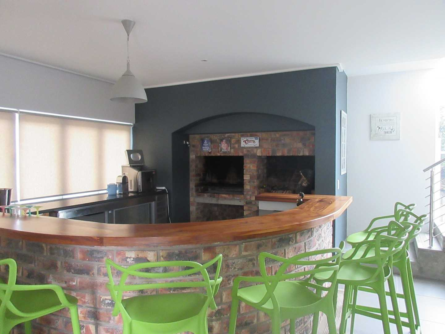bar area with two built-in braais