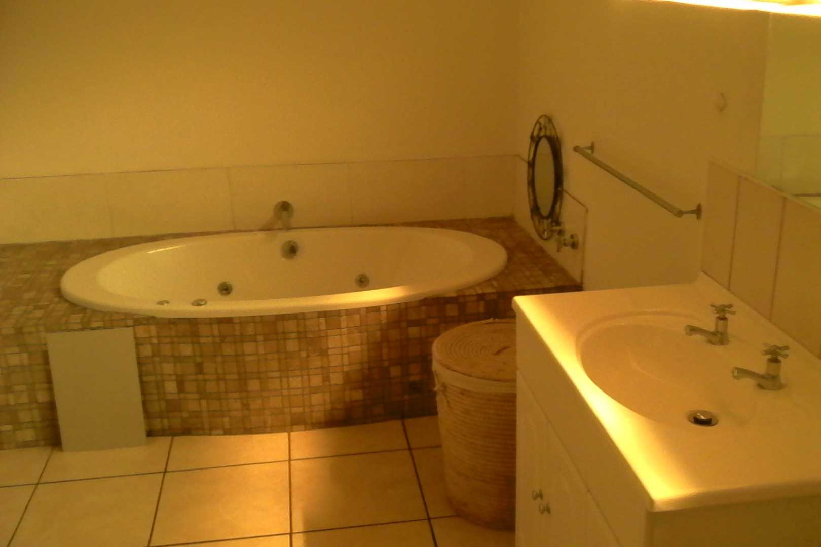 Ensuite with spa bath, basin, toilet and shower