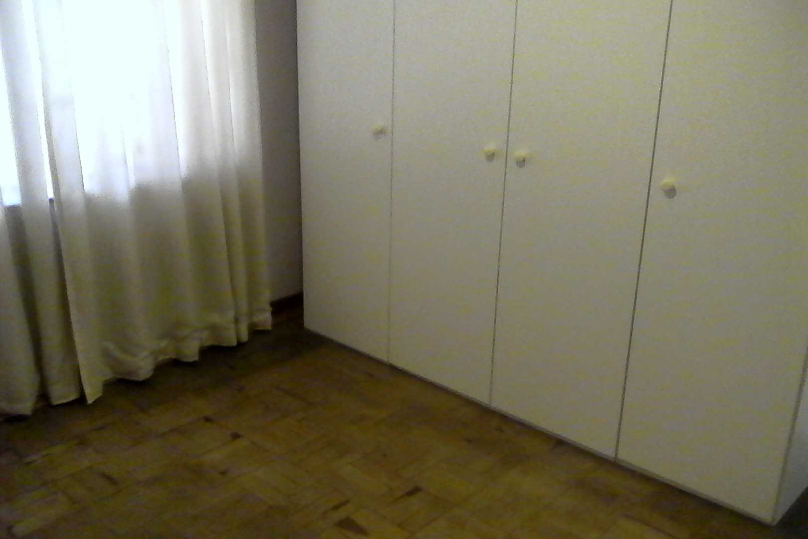 Bedroom 2 with build in cupboards, wooden floors