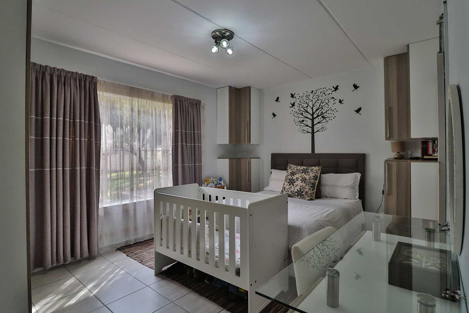 Spacious Main Bedroom features lots of extra built in cupboards and a matching  dressing table.