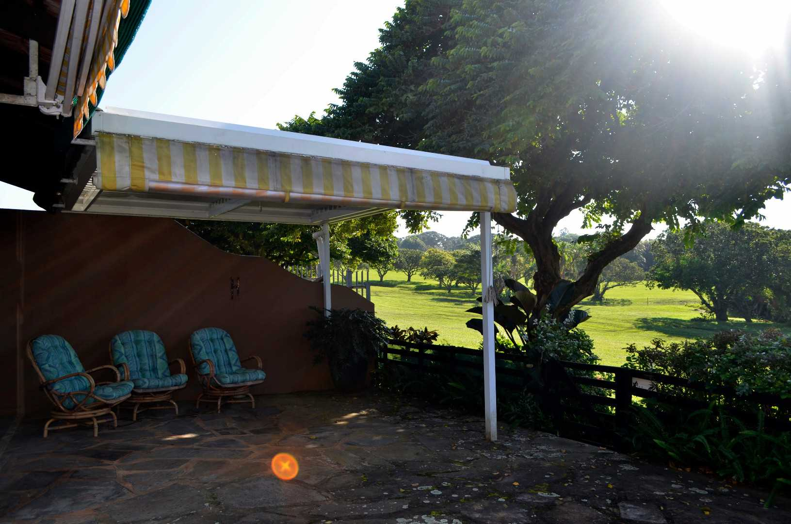 Private patio with beautiful golf course and distant sea views