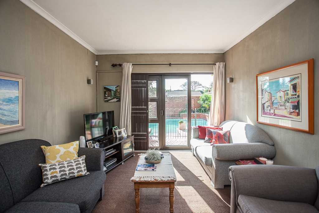 Sunny TV room overlooking pool