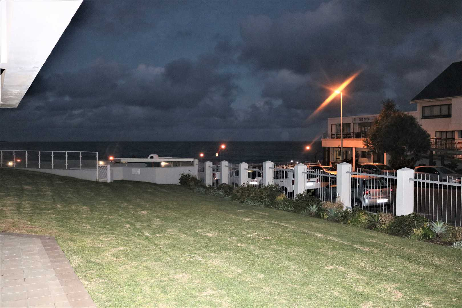 VIEW FROM PATIO AND ACCESS TO COMMUNAL POOL/BRAAI AREA