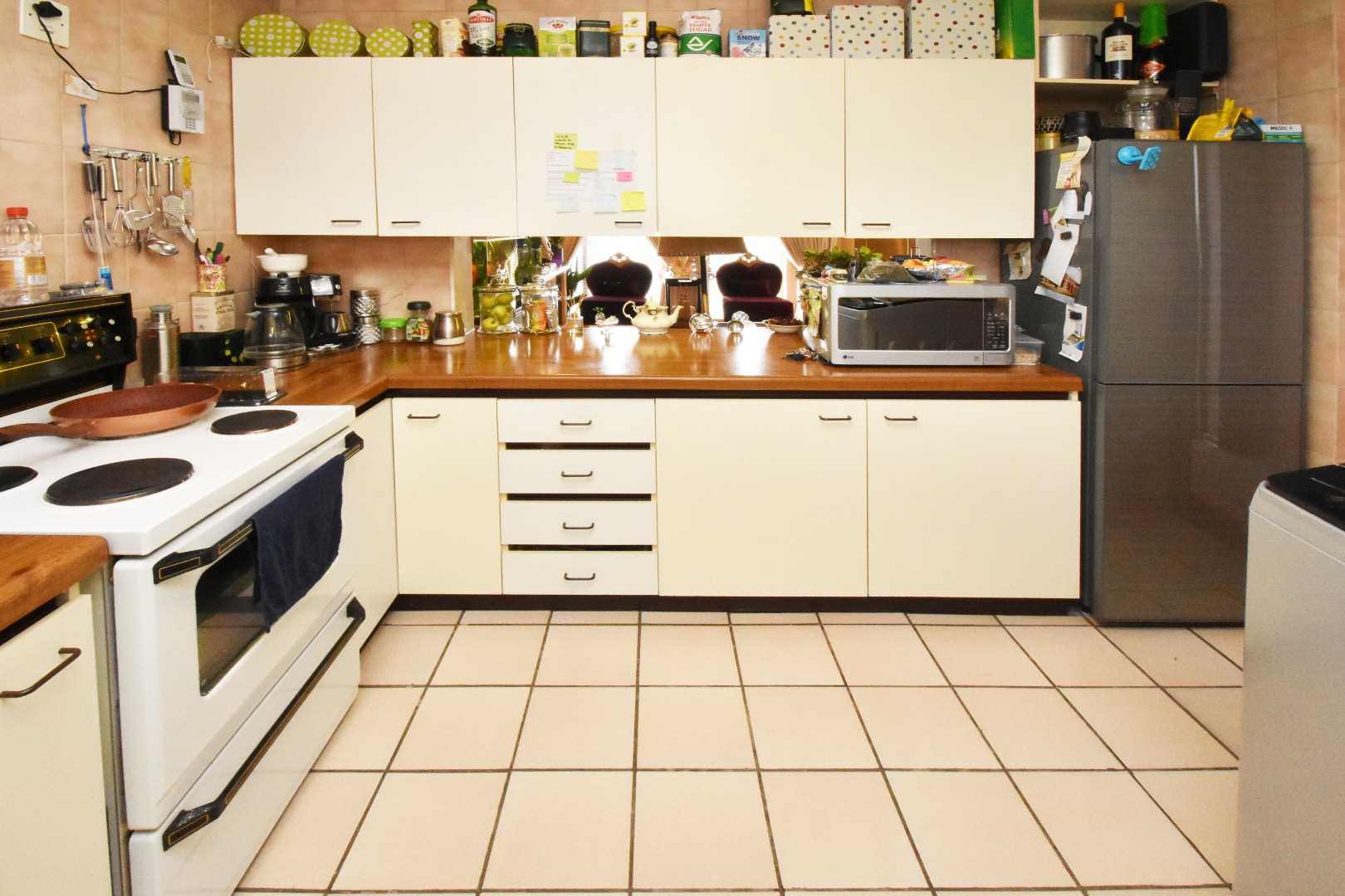 Kitchen is spacious, with plenty of cupboards and usable counter tops