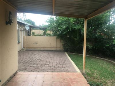 Covered patio and extra paved courtyard