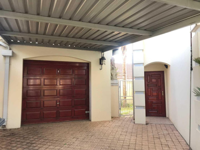 garage, carport and entrance to cottage