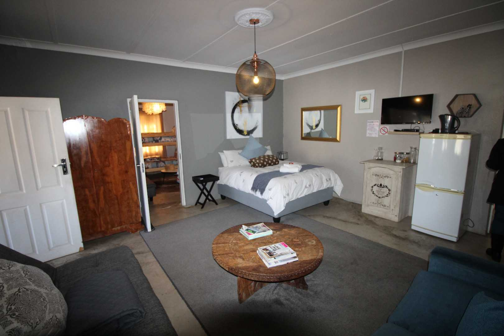Suite possible connect with extra bedroom opens up to braai area (front)