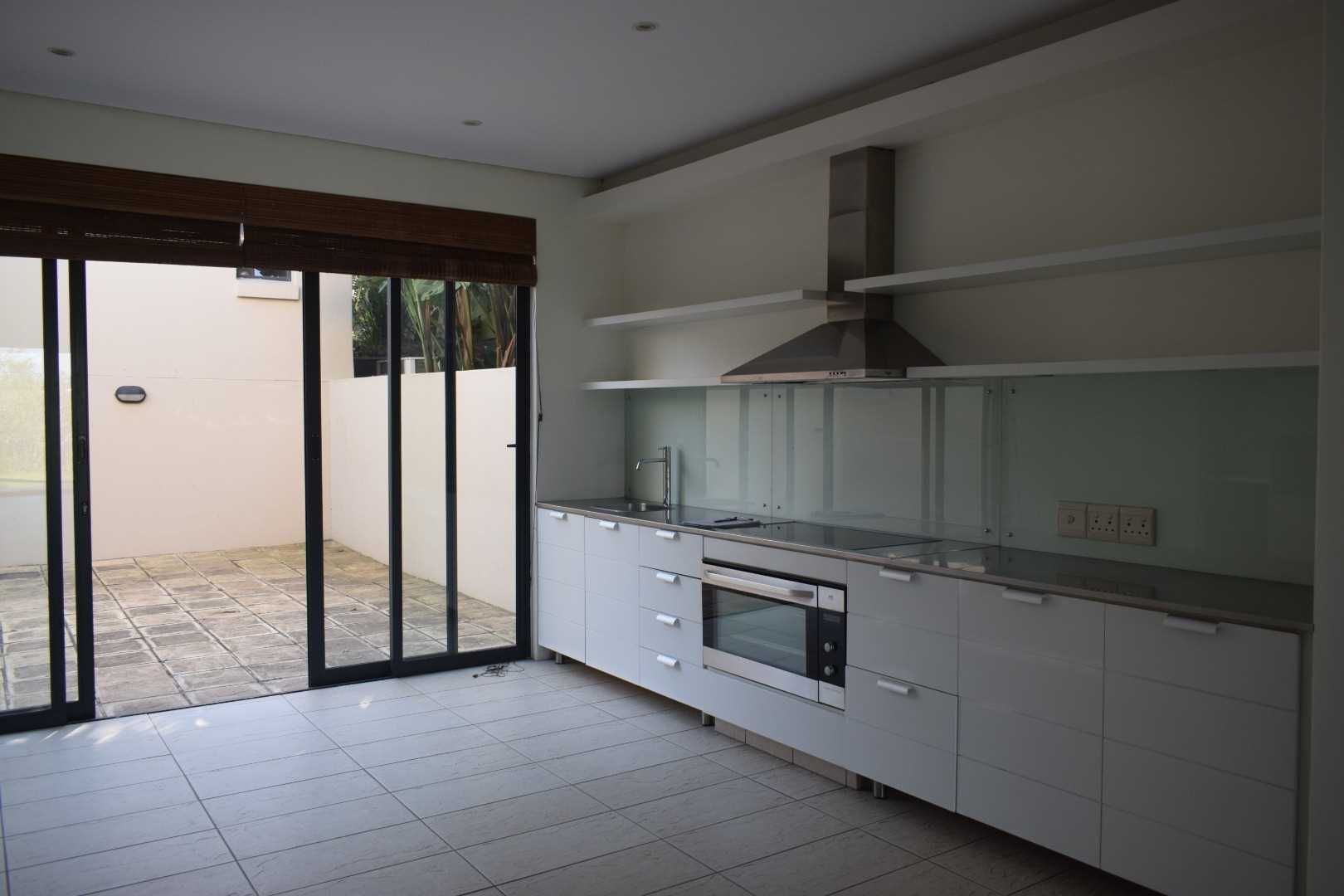 Kitchen cooking area with enclosed courtyard outside