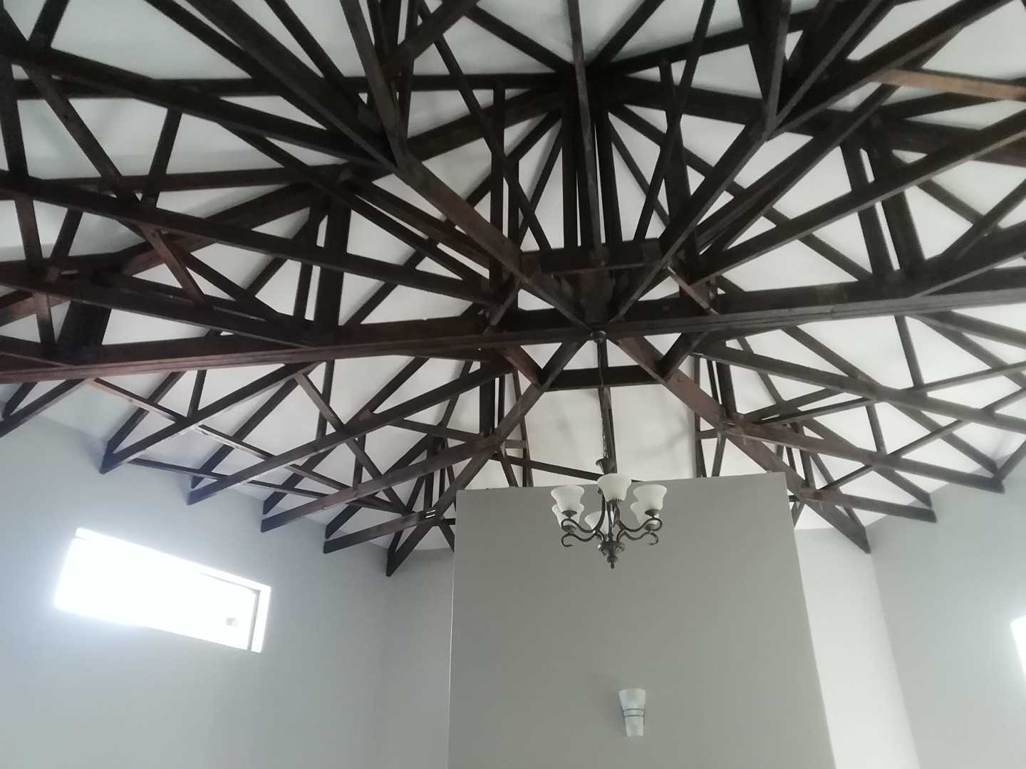Designed ceiling over living area and kitchen.