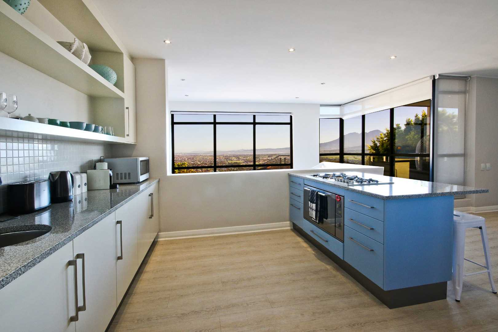 Open plan kitchen to dining area, fitted with gas hob, electric oven