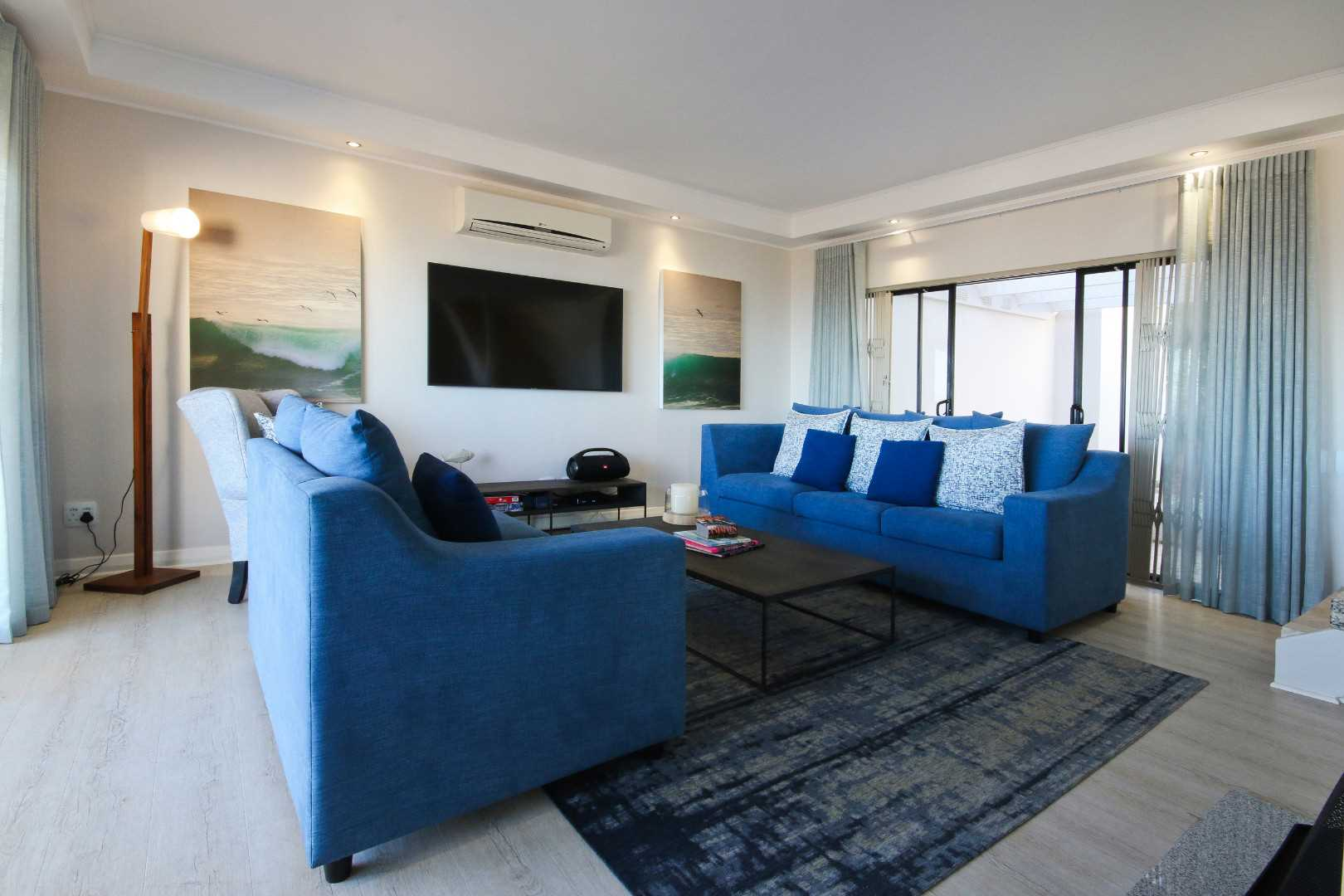 Living room with fireplace and aircon unit