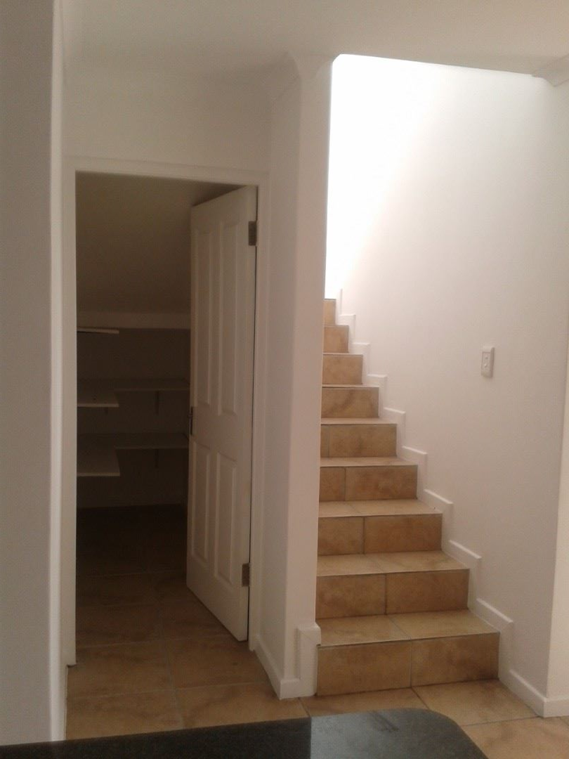 Store Room and Staircase leading to Main Bedrm and  Bathrm