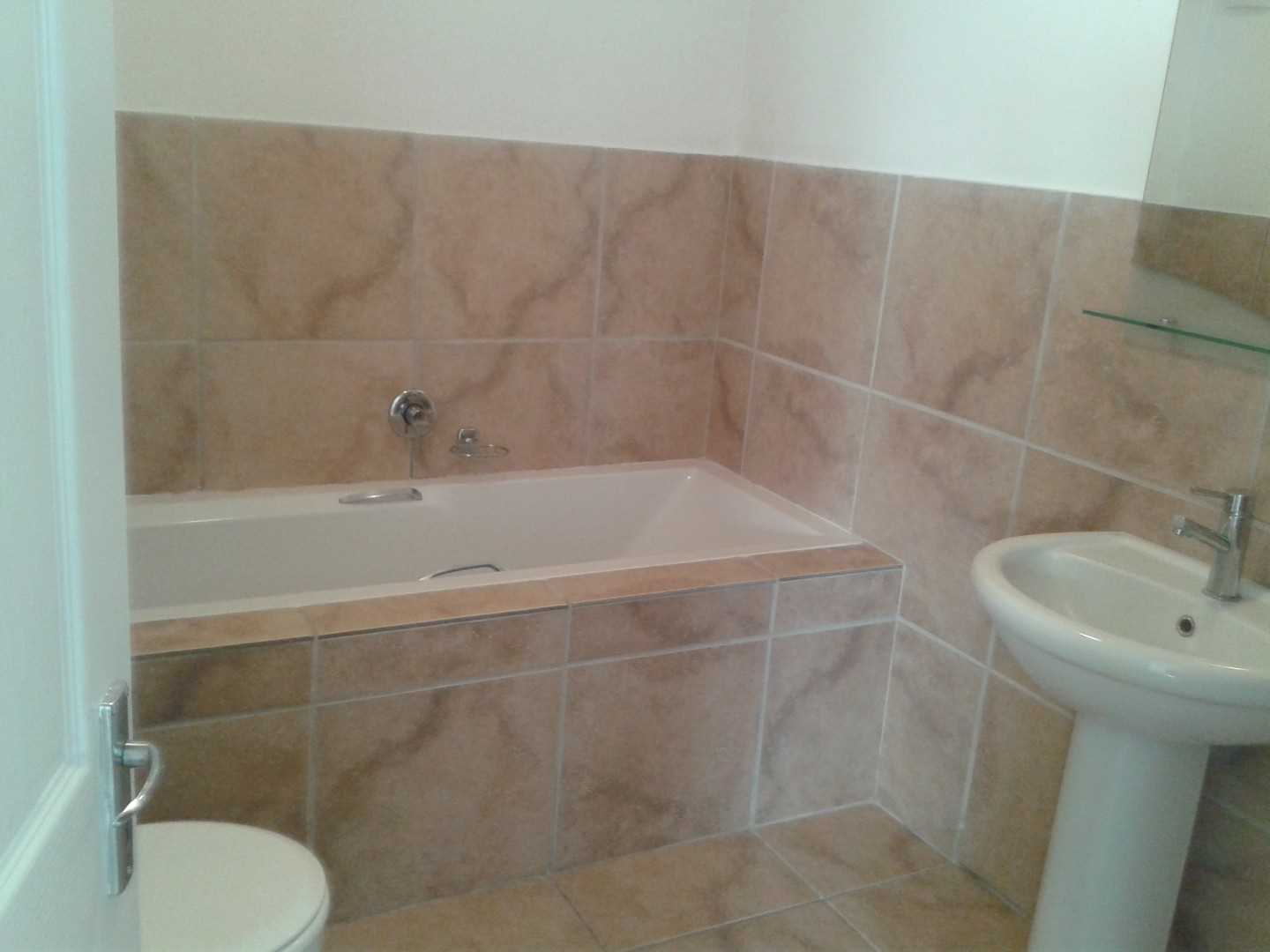 Guest Bathroom with Bath and Shower.
