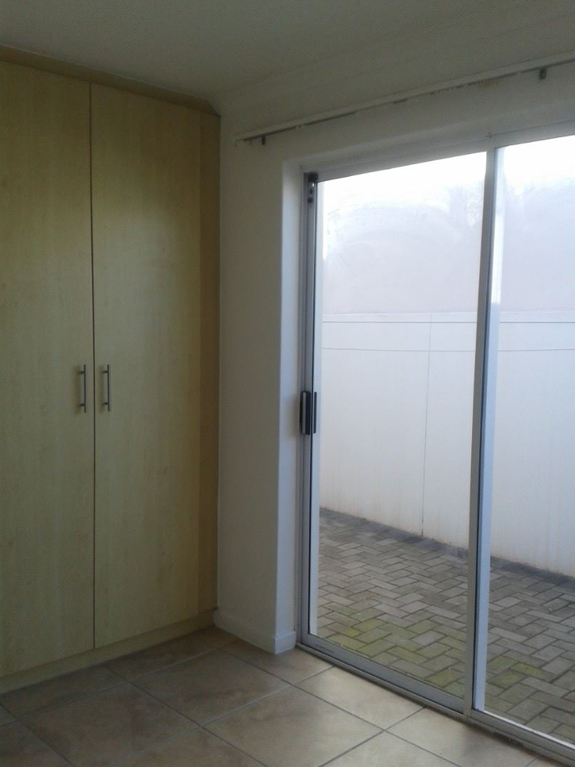 Cupboards in the Bedrooms with Sliding Door leading to an enclosed Court Yard.