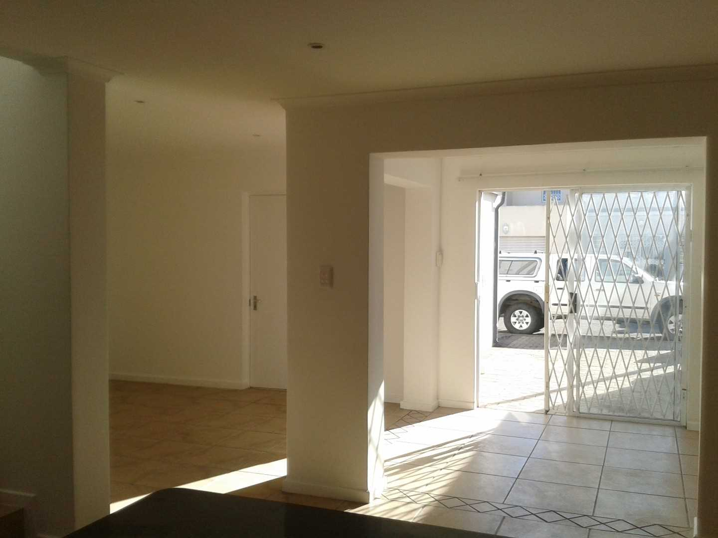 Open-plan showing direct access to Garage and Trellie -Doors.
