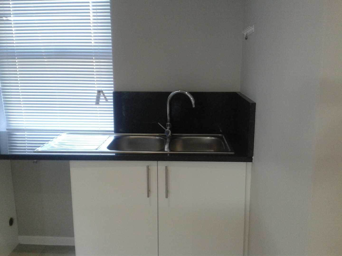 Basin with place for a Kitchen appliance.