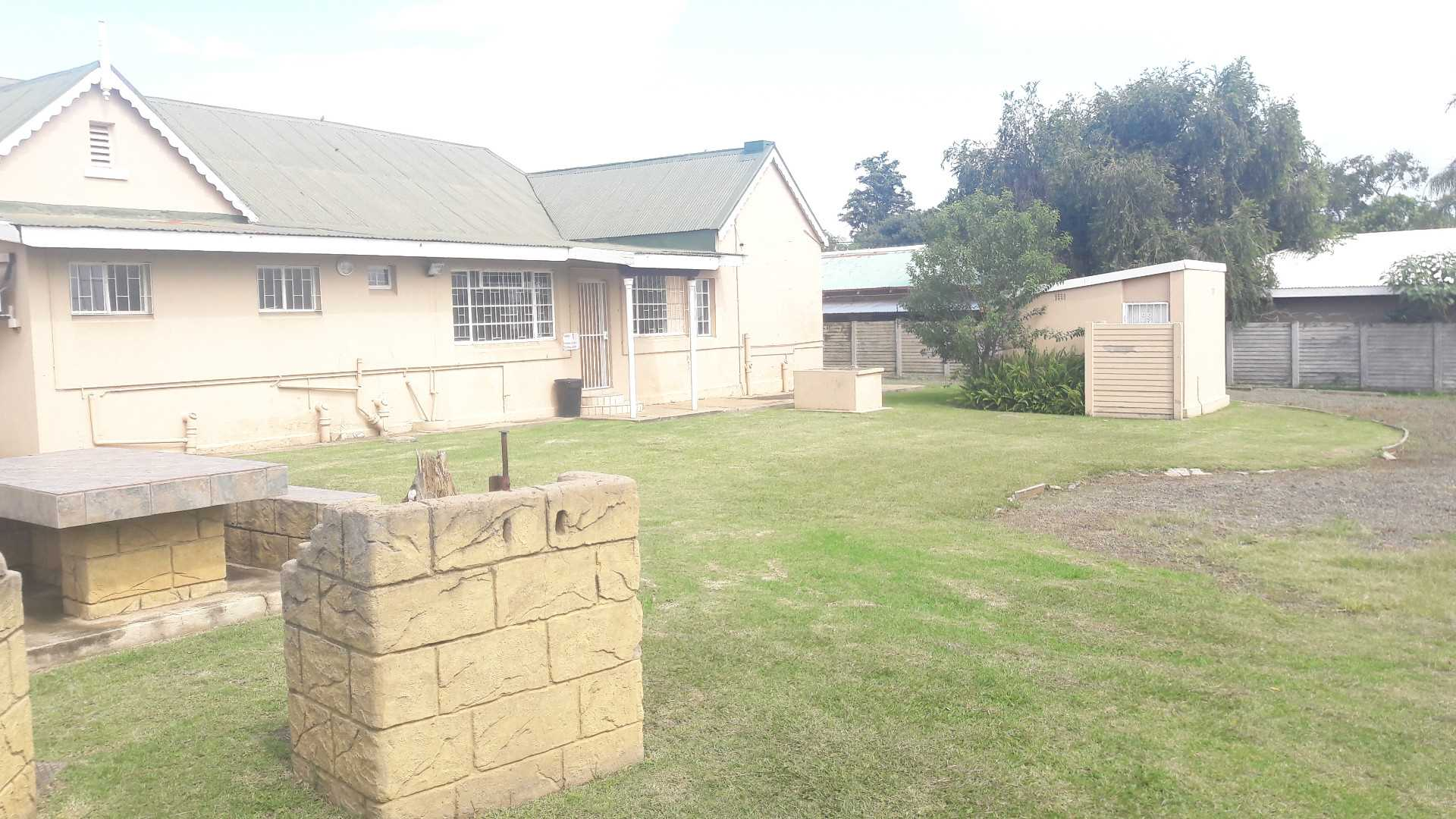 Back view of outside ablutions and braai area