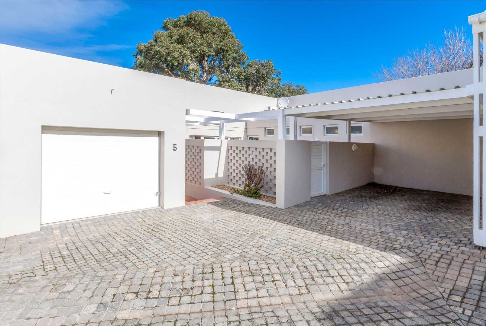 Single, direct access garage and a covered carport
