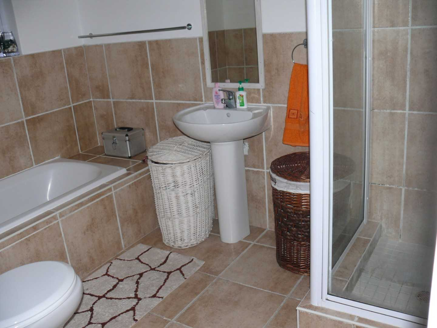Full bathroom with separate shower