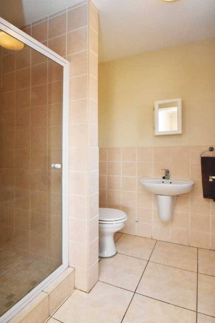 Full ensuite bathroom with shower and bath