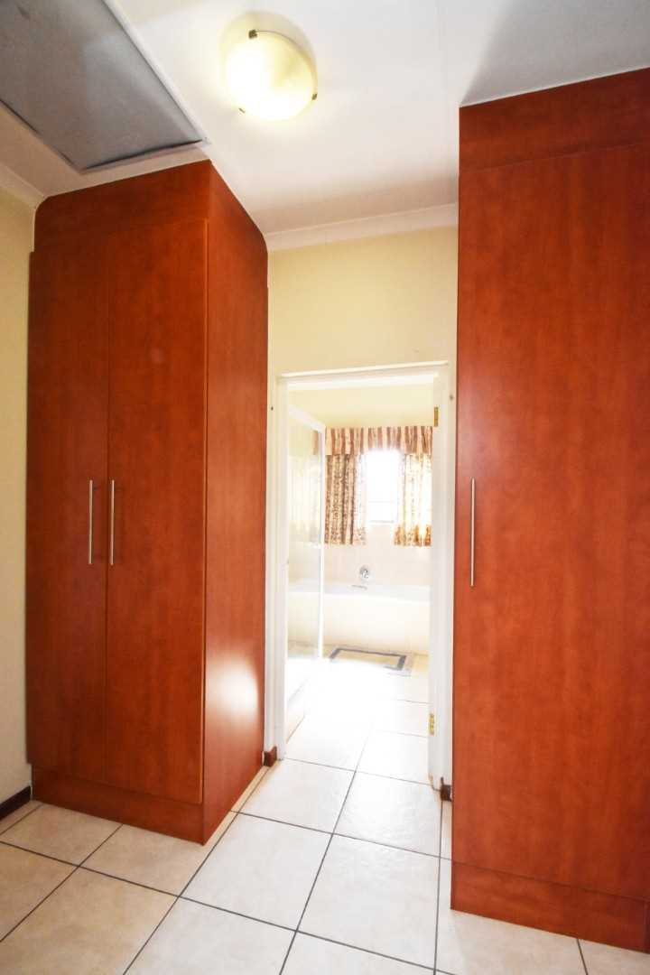 Even the passage has plenty of cupboard space