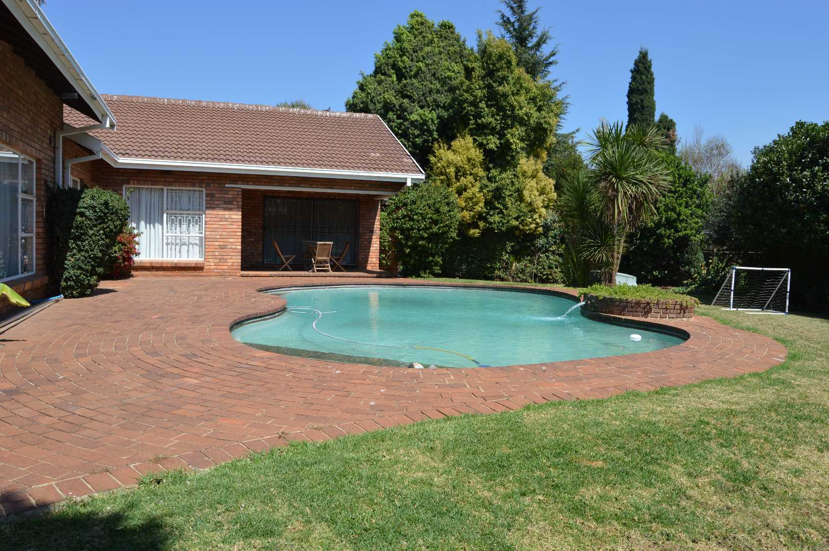 Sparkling pool and lots of space for children and pets to romp and play.